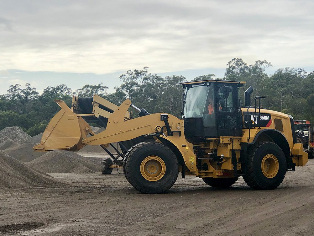 Front end loader working to move recycled concrete aggregate products around