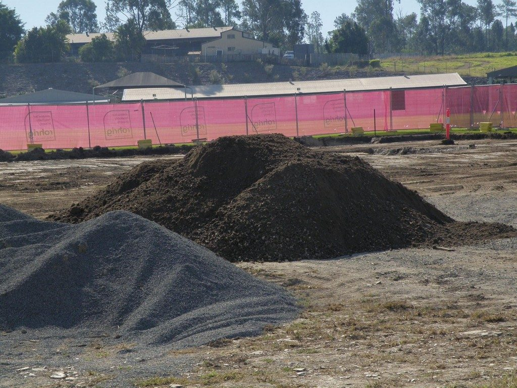 image showing piles of recycled concrete aggregates and topsoil at school building worksite