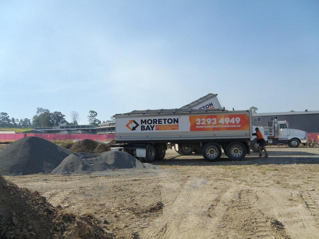 Moreton Bay Recycling trucks delivering recycled concrete aggregate products to a building site