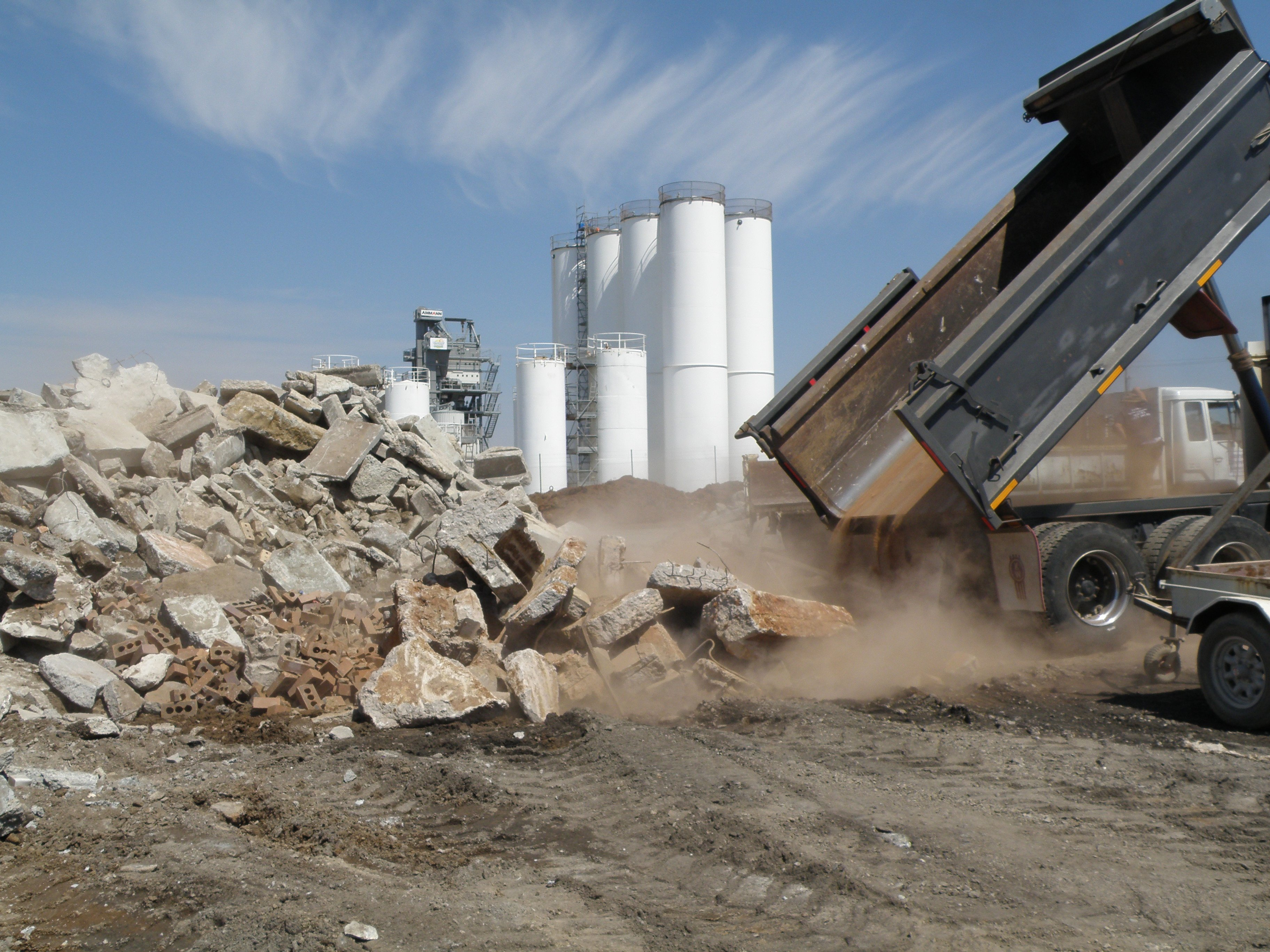 Truck dumping concrete waste at Moreton Bay Recycling facility in north Brisbane
