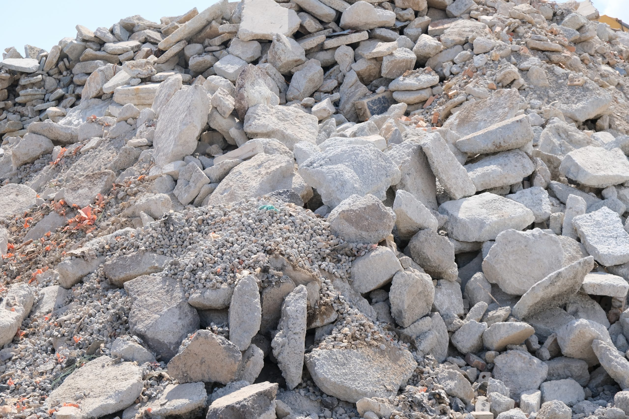 Large pile of concrete waste, waiting to be processed and recycled.