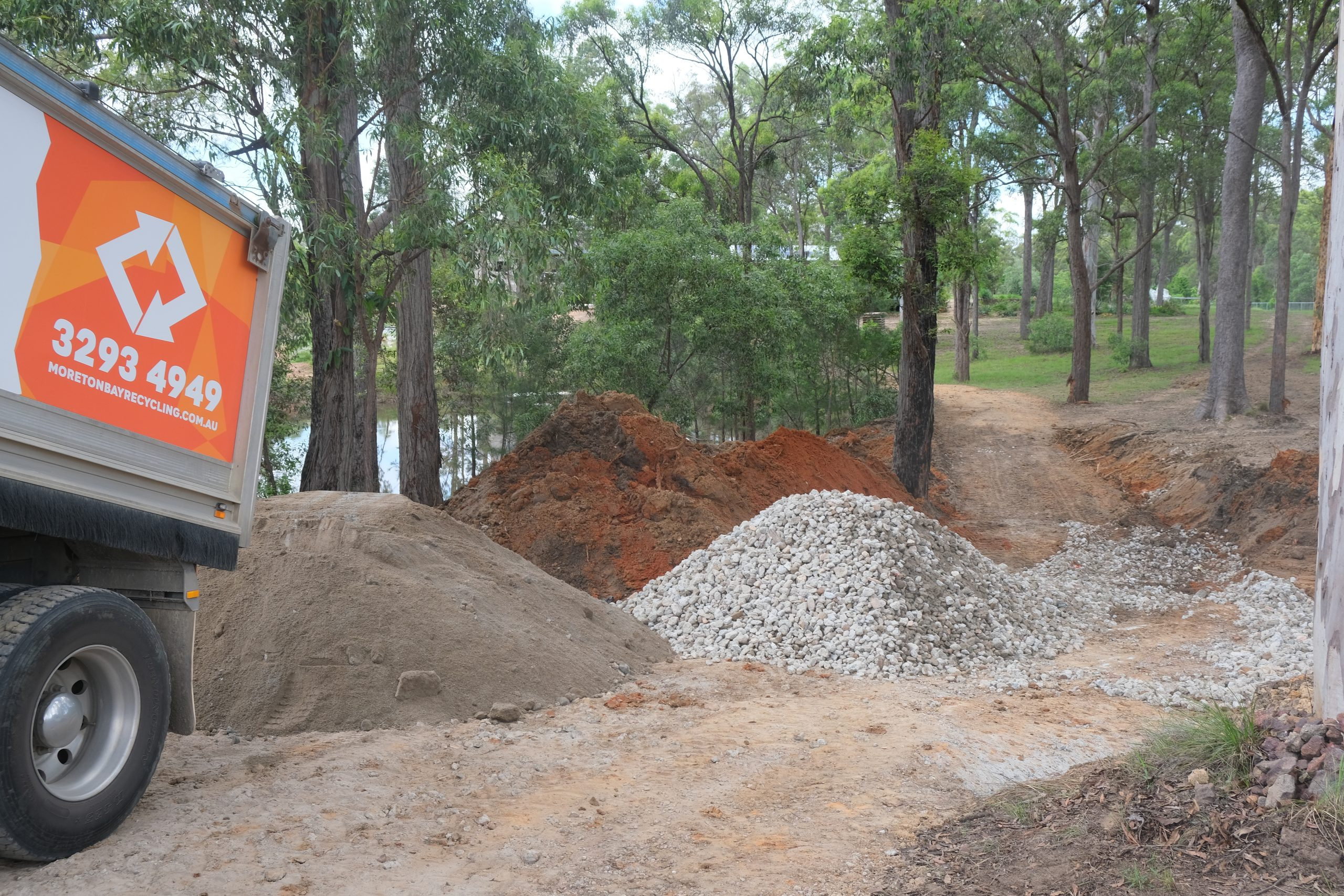 Moreton Bay Recycling road truck dumps recycled concrete aggregates at worksite