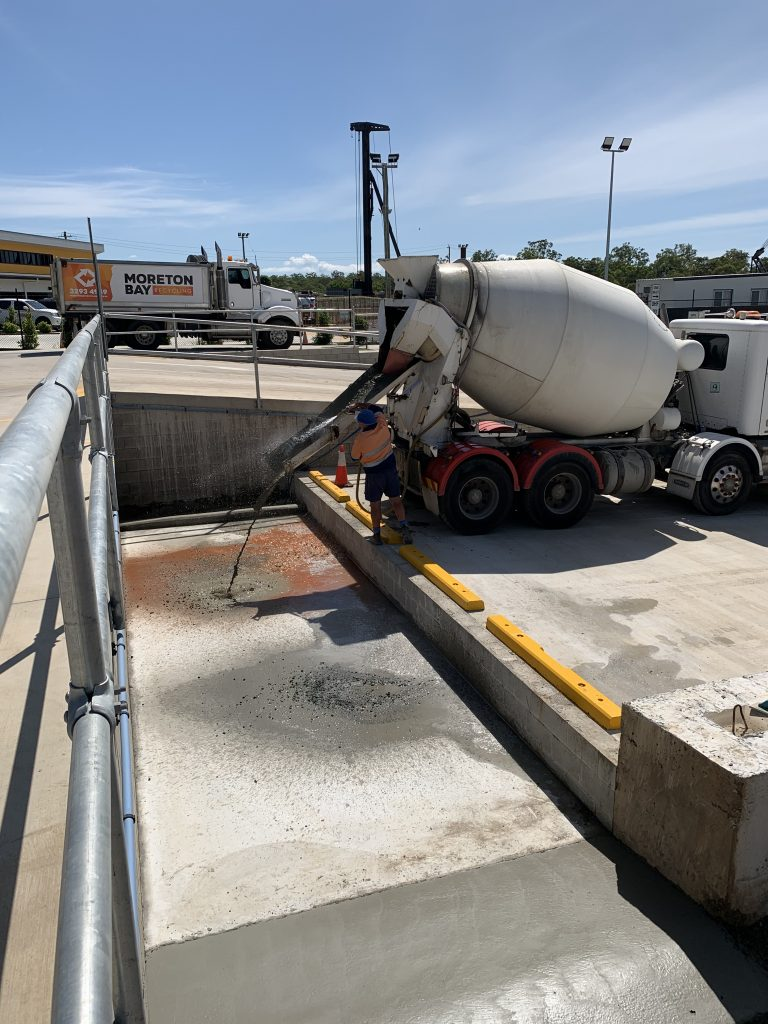A concrete truck hoses out their chute at Moreton Bay Recycling.