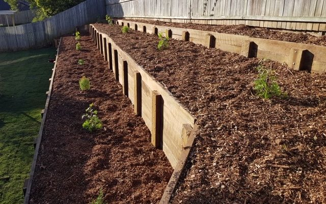 Landscaping company Dusty Map Landscaping uses mulch from Moreton Bay Recycling in a tiered garden bed.