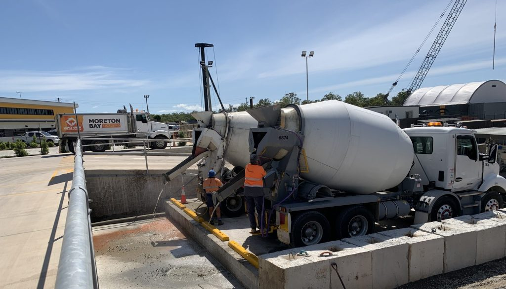 MBR's concrete pump washout station is shown with two mixer trucks.