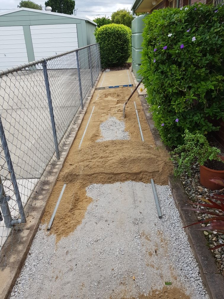 Crusher dust used as a compact base for laying a garden path.