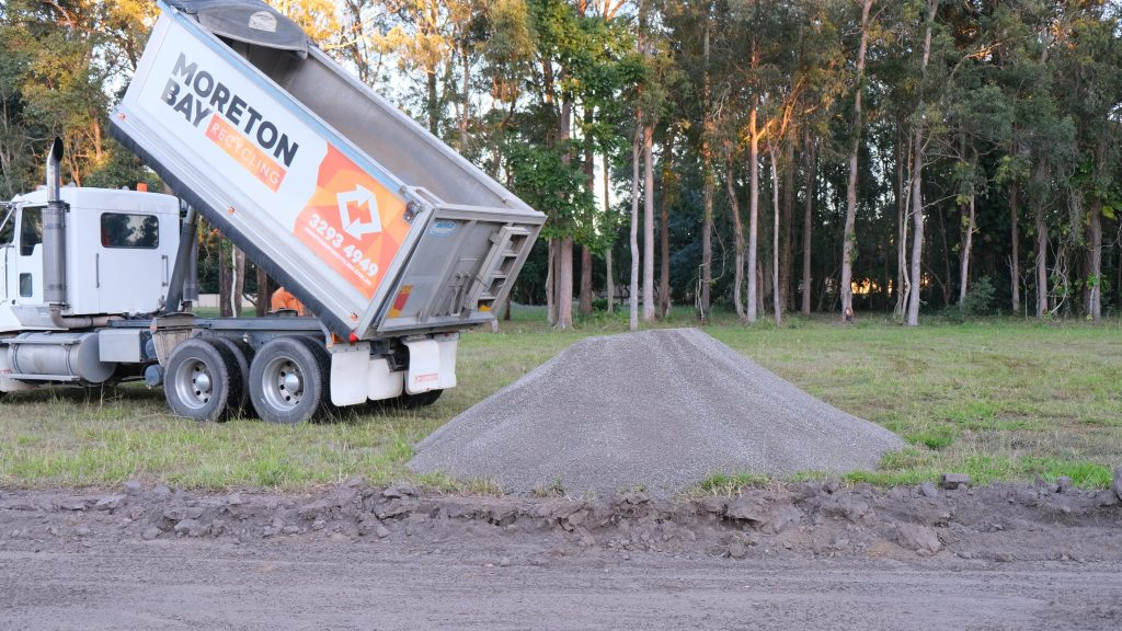 Moreton Bay Recycling truck delivers recycled concrete products onsite.
