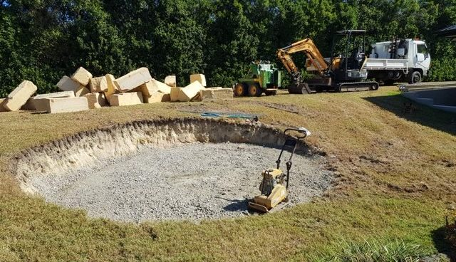 Landscaping a fire pit using non-flammable materials like crusher dust and recycled concrete aggregates.