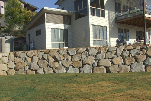 Sandstone retaining wall in front of a house in Brisbane, constructed by David from Precision Boulder Walls.