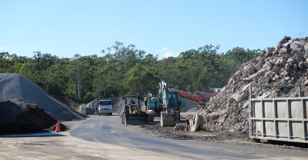The circular economy shown at Moreton Bay Recycling. Concrete waste products on the right being transformed into recycled aggregates on the left.