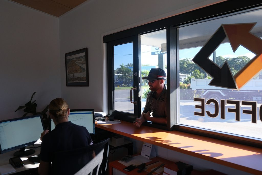 A worker reports to the Moreton Bay Recycling site office.