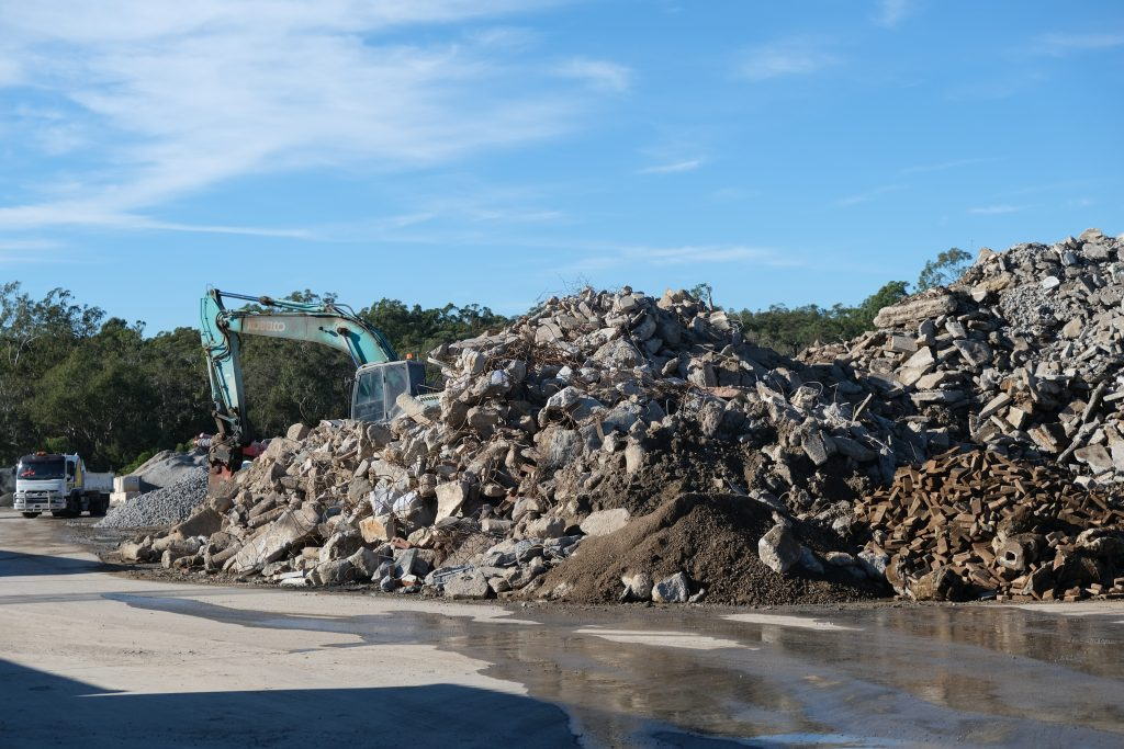 Moreton Bay Recycling's yard showing a large pile of mixed concrete waste, ready for disposal and recycling.